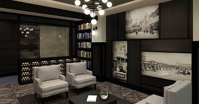 Lounge room with bookcase and seats
